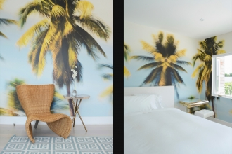 Palm Glimpse gives off easy, breezy, feel-good vibes in Sasha's bedroom.