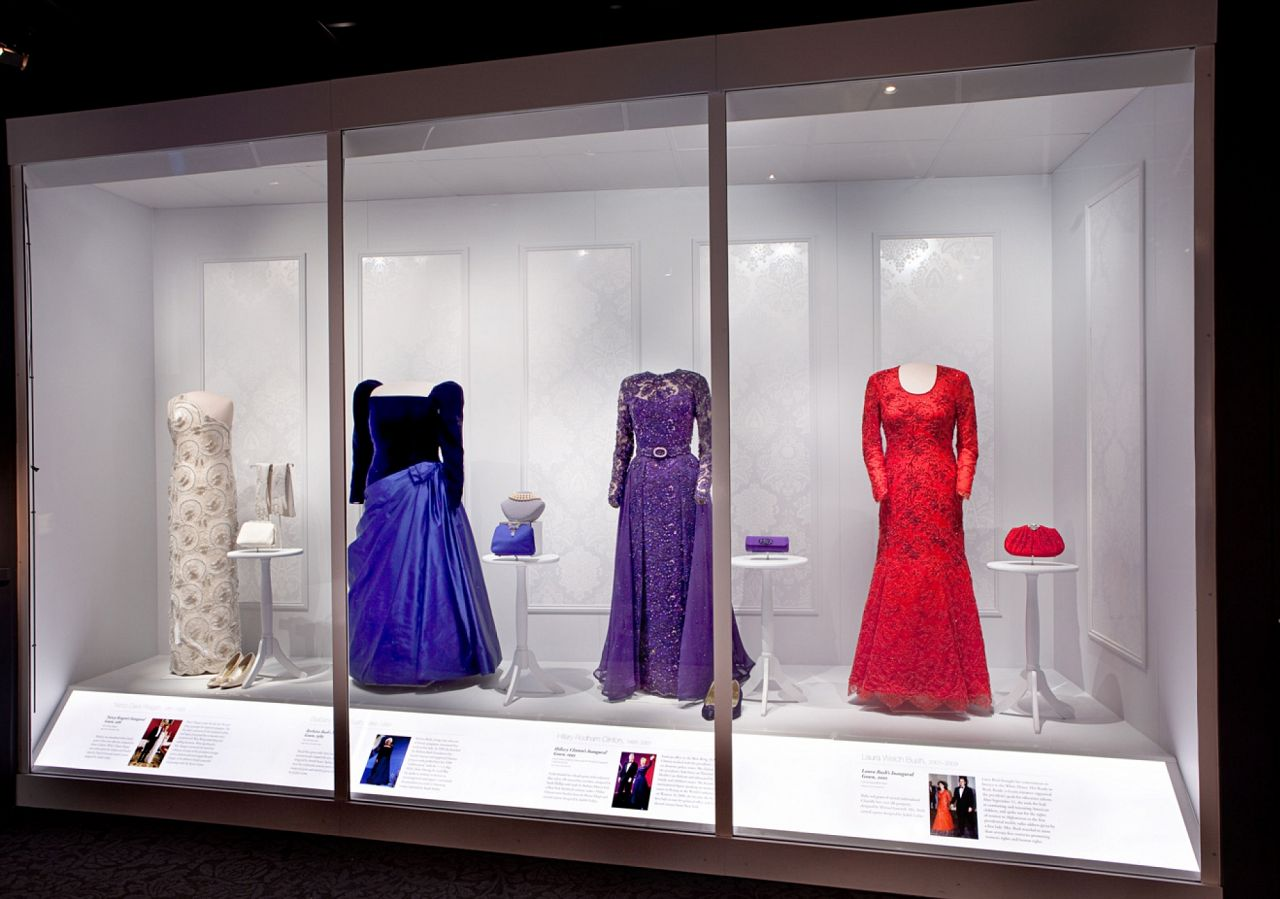 Panels of white on white Fruits of Design are the main design element in the exhibit, other than the dresses of course