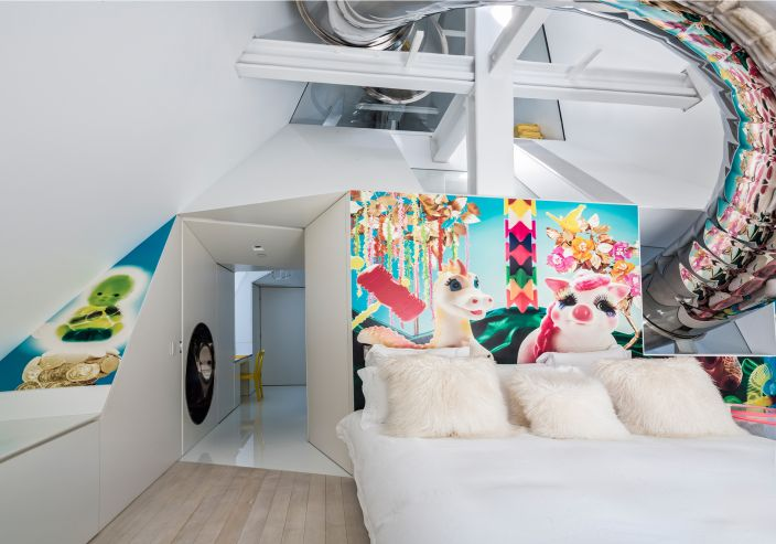 Everland prominently displayed in the guest bedroom of the the SkyHouse project by architect David Hotson and interior designer Ghislaine Viñas. It happens to be one of the most fun rooms in the home due to the large wrap of the stainless steel slide that cuts through the space and reflects the mural along its length.