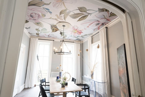 Clearly, it's time to rethink the ceiling and look to it as a sweet spot to make a major impact in a room. Here, our Camellias mural in Soft Light shines in the dining room imagined by Ana Claudia Interior Design.