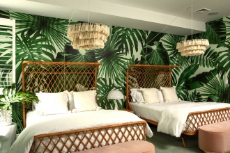 Wild Thing in Wildly Mint brings a taste of the tropics to this East Hampton, NY guest room.
