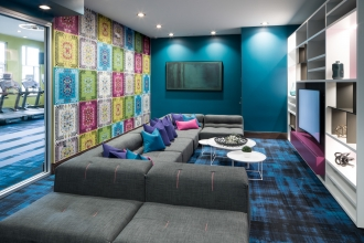 Love Monkey (created by DFC) infuses the perfect playful vibe to this lively HMARQ Studios designed apartment complex lounge in Colorado.