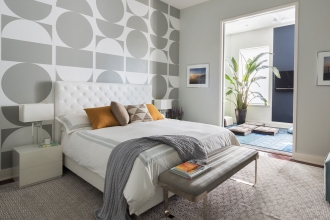Despite its dynamic design, Brasilia (in a custom colorway) infuses a sense of soothing sophistication in this Michael Garvey designed Brooklyn bedroom.    The large-scale geometric pattern, which is created by the crew at Kravitz Design, can be hung straight across or as the upside-down flip pictured here, or anyway in between. Photography by: Greg Endries