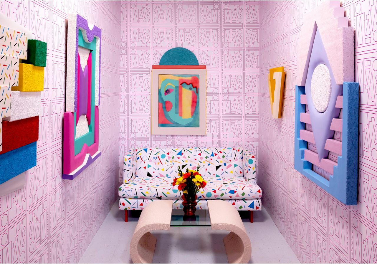 Leah Guadagnoli's lively living room is set up for visitors to interact with tactile geometric components, which play perfectly off the custom wallpaper we worked up with her. If you're interested in learning more or purchasing this design please give us a call.